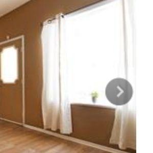 2 sets of white cotton drapes